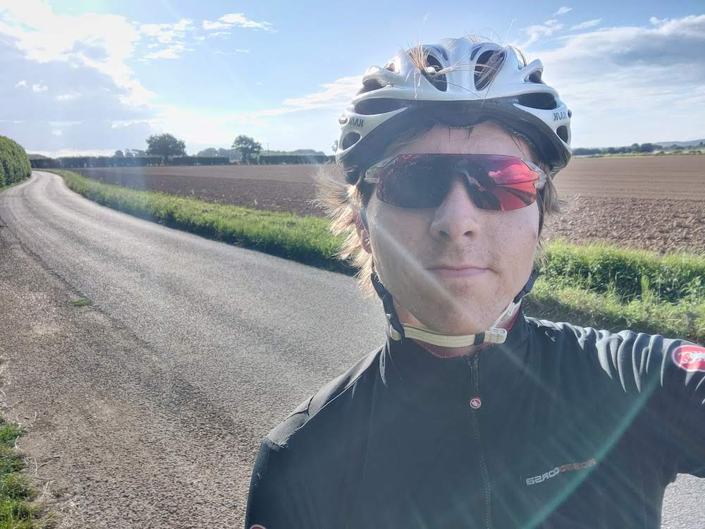 Calum in cycle gear on winding country lane