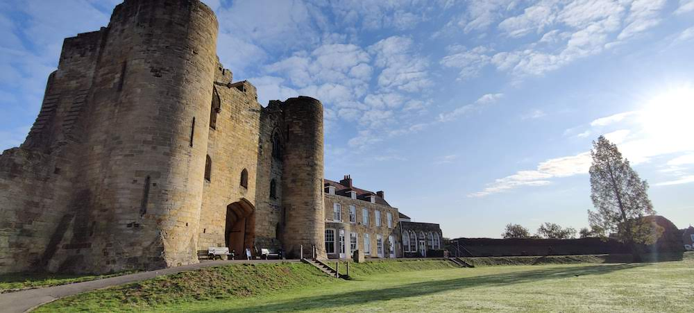 Tonbridge Castle in winter with blue sky backdrop