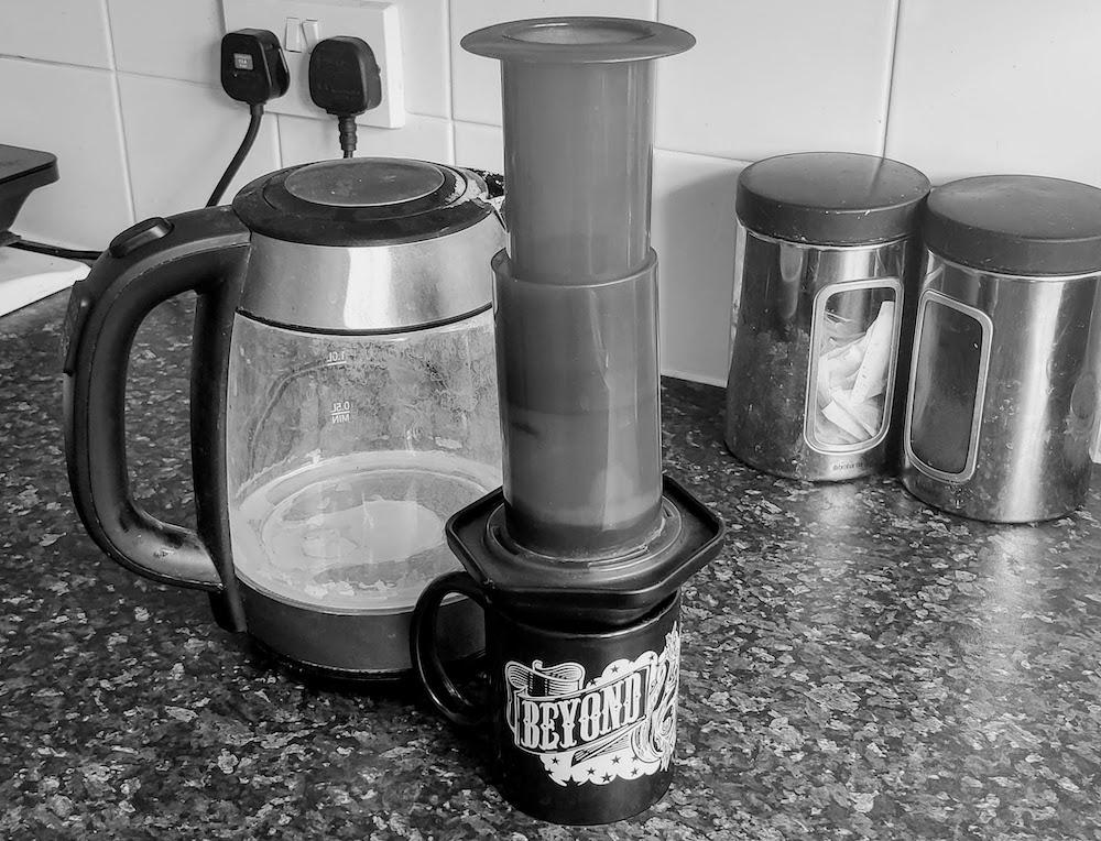 Kettle, AeroPress coffee and mug