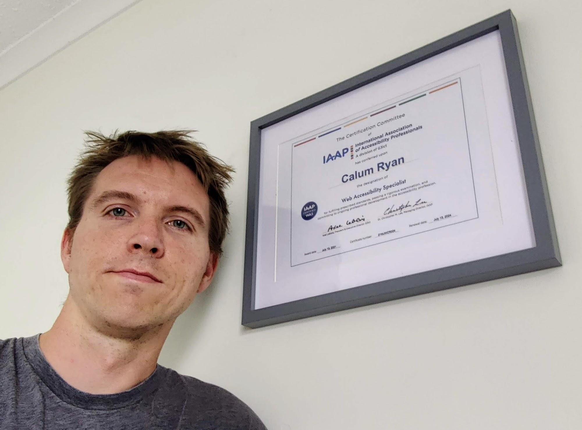 Calum beside his IAAP WAS certificate