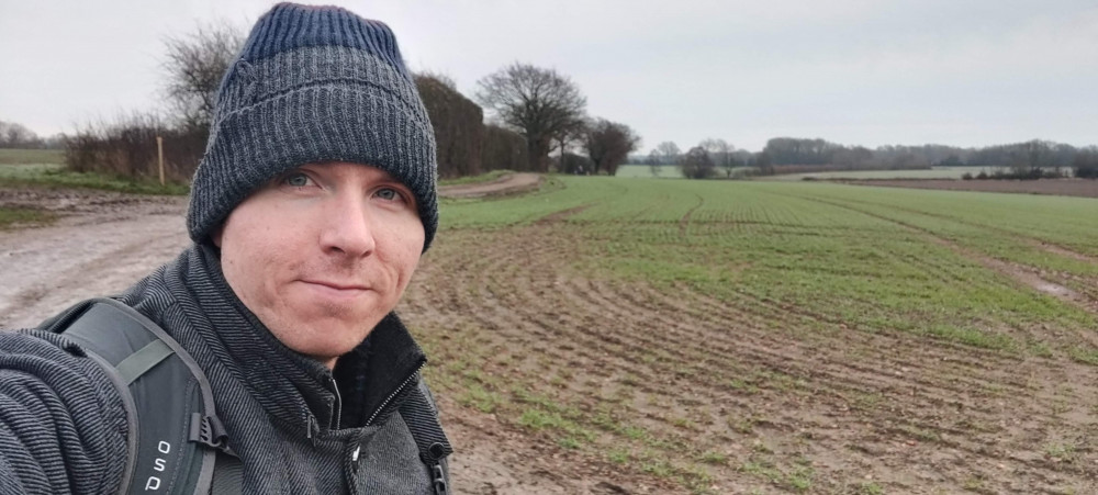 Calum standing in muddy field near Tonbridge