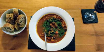 Spanish bean stew with bread and wine