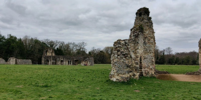 Waverley Abbey beneath a grey sky