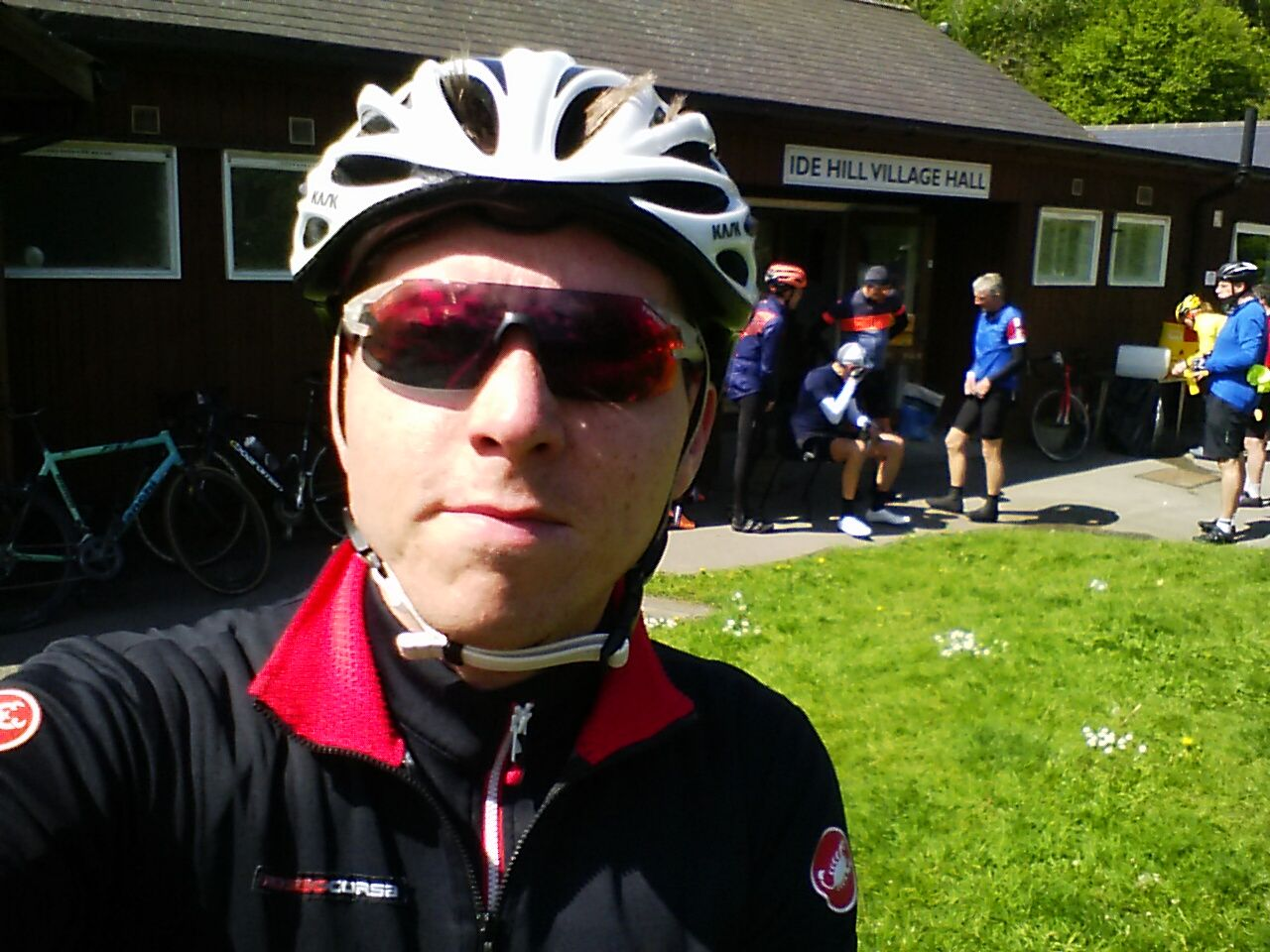 Calum in cycling wear outside Ide Hill village hall