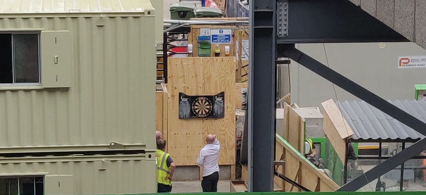 Crossrail construction site at Moorgate with men playing darts