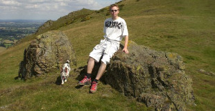 Calum on Caer Caradoc in the Shropshire Hills with his dog Berthe