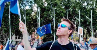 Standing on Parliament Square holding an EU flag