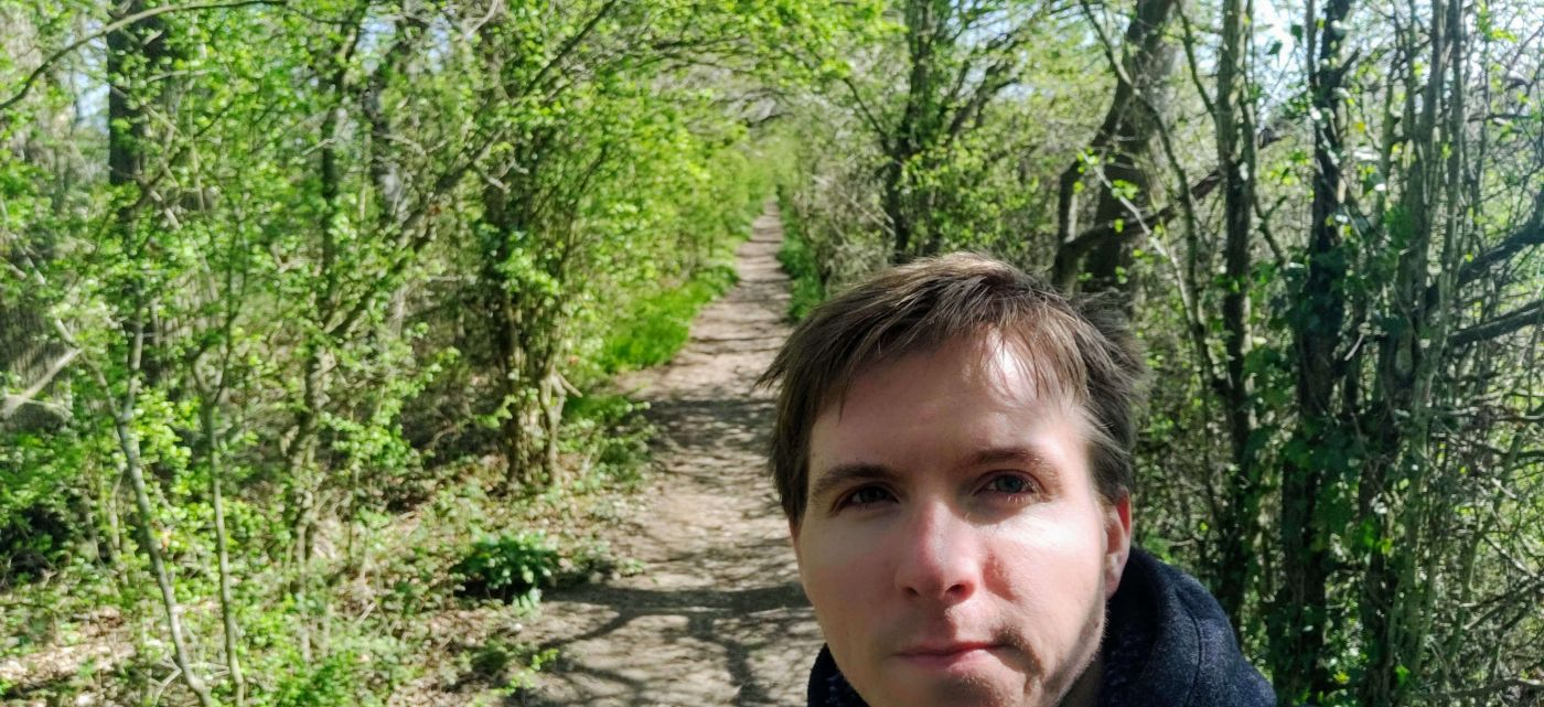Calum in a tree lined path in the North Tonbridge countryside